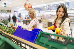 Beautiful women shopping vegetables and fruits Stock Photos