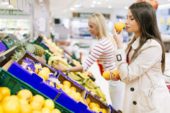 Beautiful women shopping vegetables and fruits Stock Photography