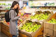 Beautiful women shopping vegetables and fruits in supermarket Stock Photos
