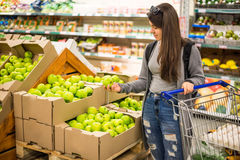 Beautiful women shopping vegetables and fruits in supermarket Stock Photo