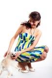 Beautiful women in short dress playing with dog