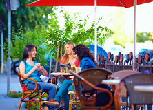 Beautiful women sitting on cafe terrace Royalty Free Stock Photos