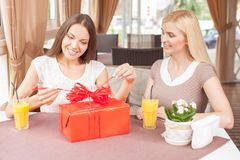 Beautiful women are spending time together is cafe Stock Photography