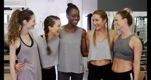 Beautiful women standing in fitness studio stock footage