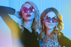 Beautiful women in star glasses Royalty Free Stock Photos