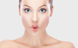 Beautiful women sucking in cheeks expression Royalty Free Stock Images
