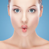Beautiful women sucking in cheeks expression Stock Photography