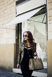 Beautiful women in sunglasses in city Royalty Free Stock Photography