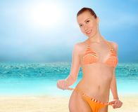 Beautiful women on the sunny tropical beach in bik. Young beautiful women on the sunny tropical beach in bikini Stock Photography
