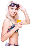 Beautiful women in swimsuit with a glass of juice Stock Images