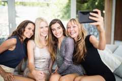 Beautiful women taking selfie with mobile phone Stock Photography