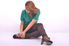 Beautiful women ties the laces on the shoe Royalty Free Stock Photo