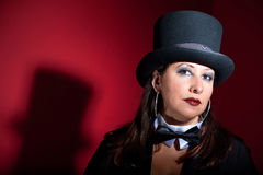 Beautiful women in top hat and bow-tie. Woman dressed like a circus ringmaster Stock Photography