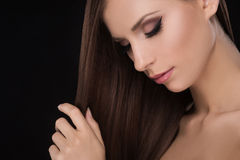 Beautiful women touching hair. Stock Images