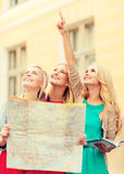 Beautiful women with tourist map in the city Stock Photo