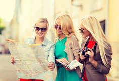 Beautiful women with tourist map in the city Stock Photos