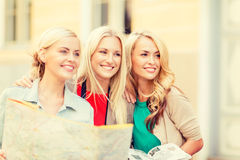 Beautiful women with tourist map in the city Stock Images