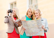 Beautiful women with tourist map in the city Royalty Free Stock Image