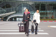 Beautiful women Traveling - Walking With Luggage At Airport Car Royalty Free Stock Photography