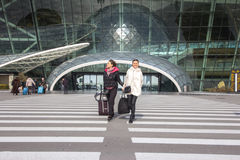 Beautiful women Traveling - Walking With Luggage At Airport Car Royalty Free Stock Images
