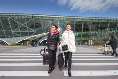 Beautiful women Traveling - Walking With Luggage At Airport Car Stock Photo