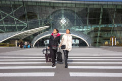 Beautiful women Traveling - Walking With Luggage At Airport Car Stock Images