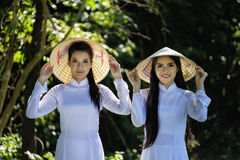 Beautiful women with Vietnam culture traditional costume in the forrest stock photo
