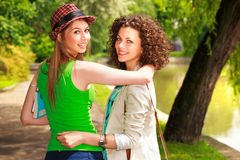 Beautiful women walking and smiling in the park Stock Photo