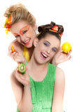 Beautiful Women wearing Fresh Fruit. Beautiful Woman and child with  a mixture of fresh vegetables and fruit and creative make-up Stock Photos