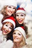 Beautiful women wearing a santa hat Stock Photos