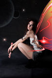 The beautiful women with wings in space Stock Photography