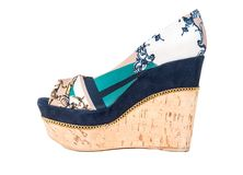 Beautiful womens shoes. Beautiful womens high platform shoes on white background stock photo