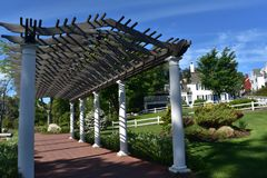Beautiful Wood Arbor in Plymouth Massachusetts on a Spring Day. Spring day with a beautiful wood arbor in Plymouth royalty free stock photos