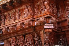 Wood carving ornamental statues on the indian temple car. royalty free stock photo