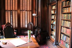 Beautiful wood cases filled with hard cover books, Victoria Mansion,Portland,Maine,2016 Royalty Free Stock Photos