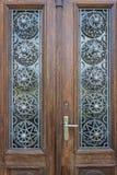 Beautiful wood door with metallic ornament Royalty Free Stock Photography
