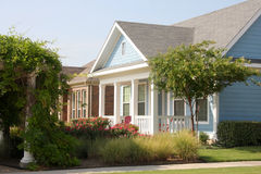 Beautiful wood house with garden. Wood blue house with garden on sunny Royalty Free Stock Photos