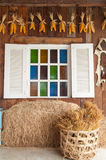 Beautiful wood window with multi color glass. And wood wall decorating with country style Stock Photo