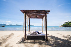 Beautiful wooden arbor on the beach. For lie back Stock Image