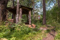 Beautiful wooden arbor on the terrenkur health trail along the Belokurikha mountain river. Belokurikha, Russia - July 30, 2015: Beautiful wooden arbor on the Stock Image