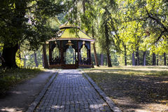 Beautiful wooden arbour and  trees in the park in autumn. Stock Image