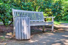 Beautiful wooden bench along a city park. Relax concept Royalty Free Stock Photos