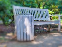 Beautiful wooden bench along a city park. Relax concept Royalty Free Stock Photography