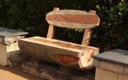 A beautiful wooden bench in the park. royalty free stock images