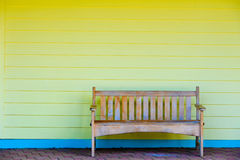 Beautiful wooden bench. With yellow decor royalty free stock image