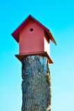 Beautiful wooden bird cage on a wooden pole Royalty Free Stock Photography