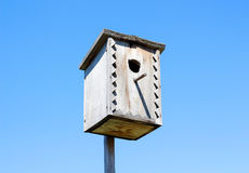 Beautiful wooden birdhouse. On the background of blue sky in a S Royalty Free Stock Images