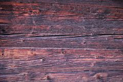 Background. Beautiful wooden boards, the wall of a wooden antique house in brown, red and pink tones. Beautiful wooden boards, the wall of a wooden antique royalty free stock image