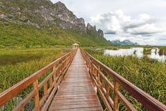 Beautiful of wooden bridge and lake in Sam Roi Yot National Park Stock Photo