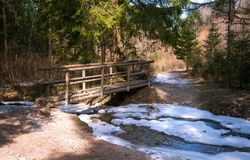 Beautiful wooden bridge over a frozen river stock photos